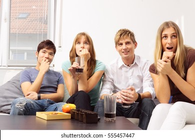 Friends Having A Small Party At Home