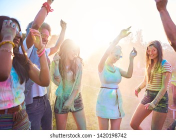 Friends in holi colors celebrating festival on fresh air