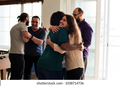 Friends hugging each other
