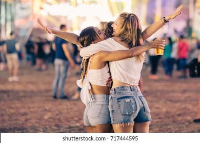 Friends hugging on music festival