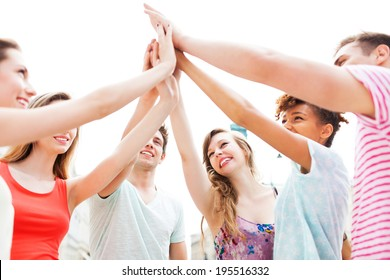 Friends joining hands