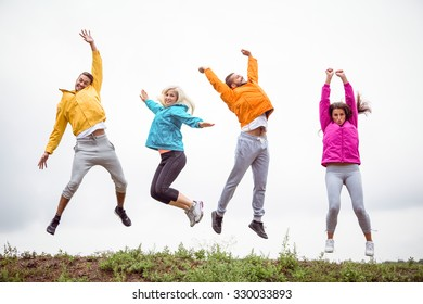 Friends jumping before a hike in the countryside