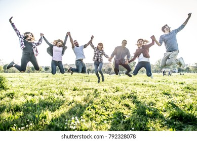 Friends jumping high in the park