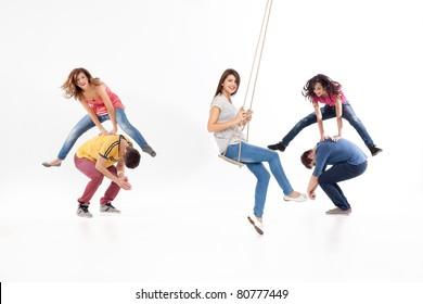 friends jumping, swinging, playing, having fun