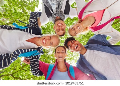Friends laughing with joy and having fun in group hug