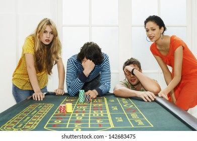 Friends Losing On Roulette Table