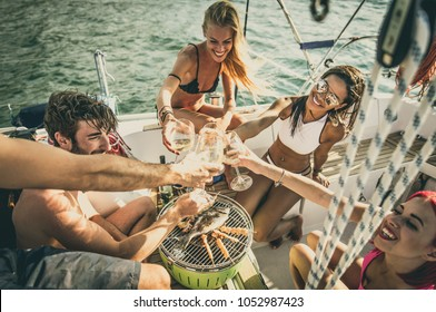 Friends making fish barbecue on the yacht