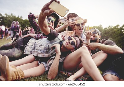 Friends making selfie at the summer festival