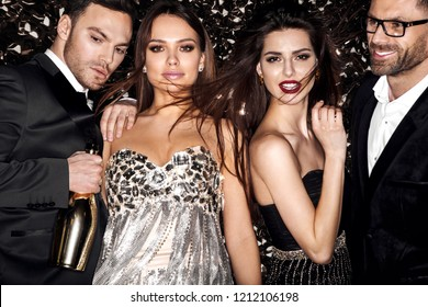 Friends on celebrating, party. Hollywood stars. Shine background.