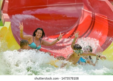 Friends on a water slide in the water park