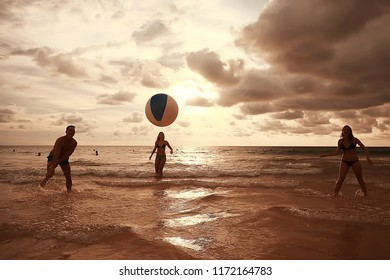friends play a ball in the water / fun in summer vacation game with a ball in the water