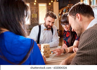 Friends play  board games at the table