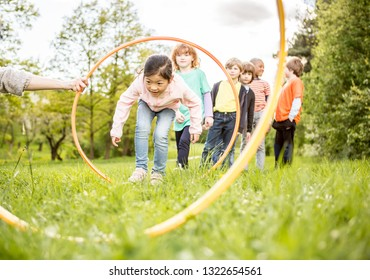 Friends playing with a hoop in the nature
