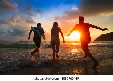 Friends playing on beach, Ko Kut Thailand