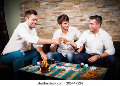 friends playing poker and drinking rum shots