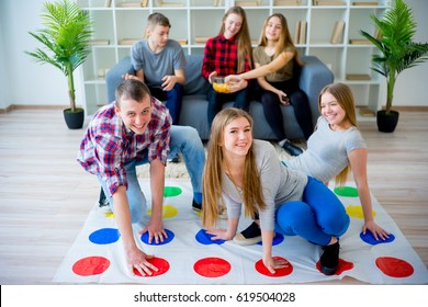 Friends playing twister