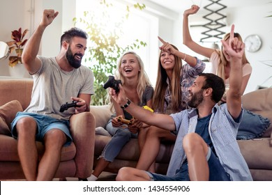 Friends playing video games on console,having fun together.