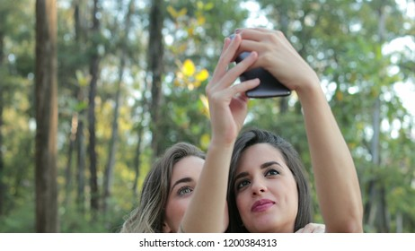 Friends posing for a slefie with cellphone