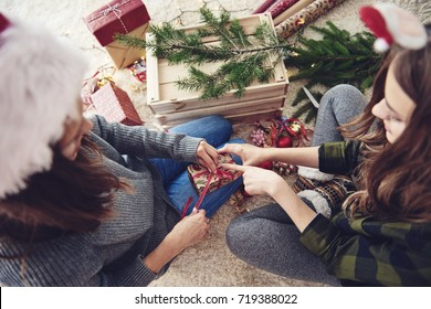 Friends preparing gifts for christmas