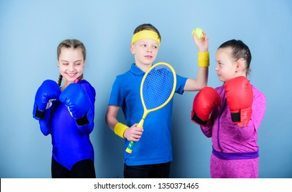 Friends ready for sport training. Sporty siblings. Child might excel completely different sport. Girls kids with boxing sport equipment and boy tennis player. Ways to help kids find sport they enjoy.