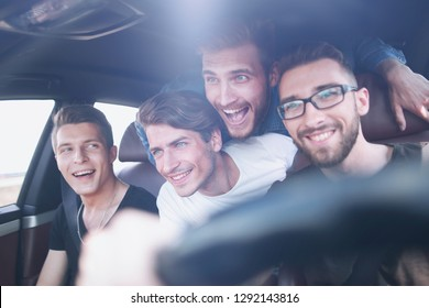 Friends renting a car and driving somewhere