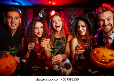 Friends resting in nightclub at Halloween