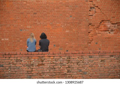 Friends seating on wall
