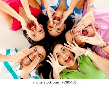 Friends shouting and lying on the floor - isolated over a white background