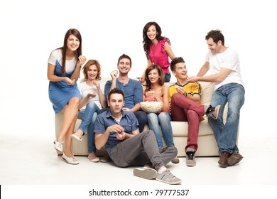 friends sitting on couch laughing at comedy movie