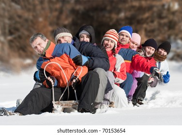 Friends sliding and having fun in winter
