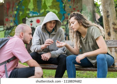 Friends smoking weed in the park.
