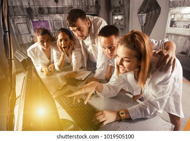 Friends are solving quests to get out of escape room stylized like laboratory.