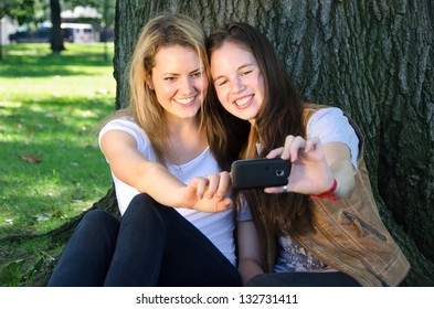 Friends Taking a Cell Phone Photo in the Park