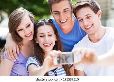 Friends taking photo outside