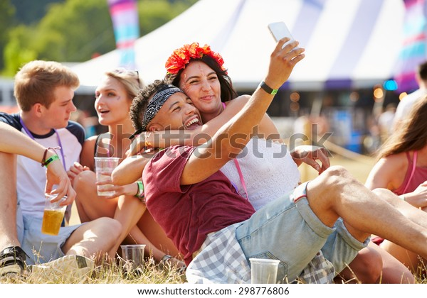 Friends taking selfie at a music festival