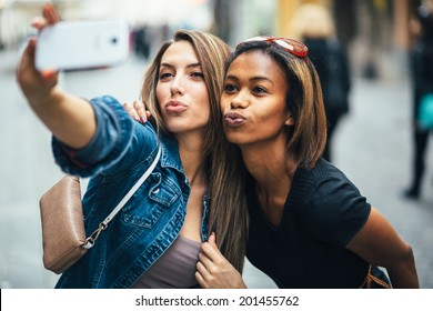 Friends taking a selfie on the street