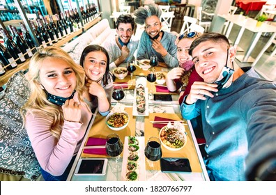 Friends taking selfie at sushi bar restaurant - New normal lifestyle concept about young people having fun together at fashion diner with open face masks - Bright saturated filter - Focus on right guy
