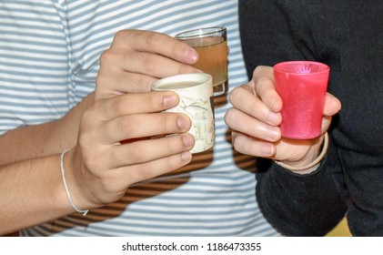 Friends taking shots of alcohol together at a party