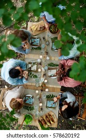 Friends talking by served festive table