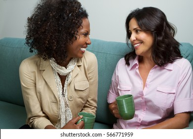 Friends talking and having Coffee and talking.