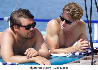 Friends talking and sunbathing on board a private yacht in the Maldives, Laamu Atoll, Indian Ocean, Maldives, Asia