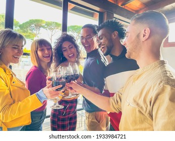 Friends toasting and drinking red wine at restaurant - Food lifestyle concept with happy people having fun together - Concept about with happy people having fun together at winery bar