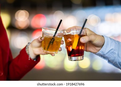 Friends toasting glasses in a disco