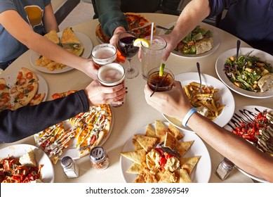 Friends Toasting at a Meal