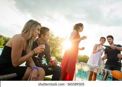Friends toasting at party for the happy hour