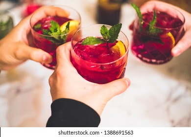 Friends toasting with sangria in a Spanish restaurant