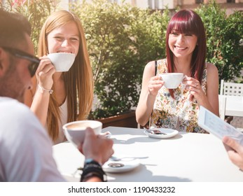 Friends together talgking and having a coffee in a bar outdoor in italy