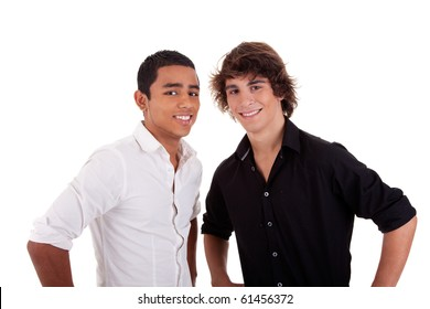 friends: two young man of different colors,looking to camera and smiling, isolated on white, studio shot