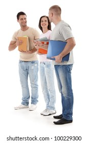 Friends at university standing talking to each other, holding books and notes, smiling happily, isolated on white.