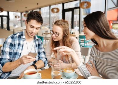 Friends using smartphones together